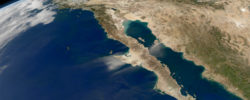 Satellite: Aqua  Sensor: MODIS  Date: 27 November 2011  Time: 20:50 UTC  Description: Dust clouds blowing out of Mexico across an otherwise               cloud-free view of Baja California  Red channel: Band 1 (620-670 nm)  Green channel: Band 4 (545-565 nm)  Blue channel: Band 3 (459-479 nm)  Projection: Near-sided perspective from              2124 kilometers above 6 North by 110 West  Image created by: Norman Kuring